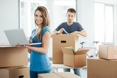 Couple using a laptop in their new house stock photos