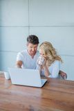 Couple using a laptop together Stock Image