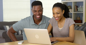 Couple using laptop together at desk Royalty Free Stock Photo