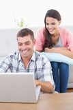 Couple using laptop together Royalty Free Stock Photo