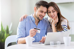Couple using laptop together Stock Image