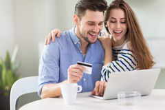 Couple using laptop together Royalty Free Stock Image
