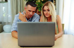 Couple using laptop together. Young couple using laptop together Stock Photography