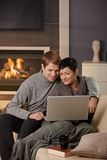 Couple using laptop at winter Stock Images