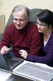 Couple using laptops stock photography