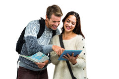 Couple using map and digital tablet while traveling Royalty Free Stock Photo