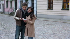 Couple using map and smartphone in city stock footage