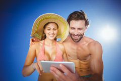 Couple using mobile phone on a sunny day Royalty Free Stock Images