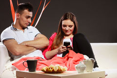Couple using mobile phone texting messages Royalty Free Stock Photos