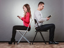 Couple using mobile phones not talking. Conflict. Stock Images