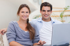 Couple using a notebook Stock Image