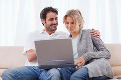 Couple using a notebook Stock Images