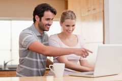 Couple using a notebook while having coffee Stock Images