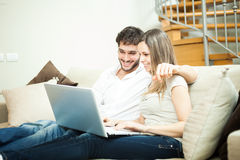 Couple using a notebook Stock Photos