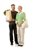 Couple: Using Paper and Fabric Grocery Bags Stock Photography