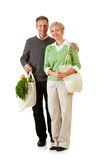 Couple: Using Paper and Fabric Grocery Bags Royalty Free Stock Photography