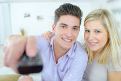 Couple using remote control Royalty Free Stock Photography