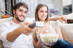 Couple using a remote control Stock Photo