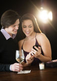 Couple Using Smart Phone In Night Club Royalty Free Stock Photos