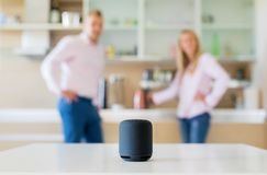 Couple using smart speaker at home royalty free stock photo