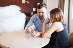 Couple using smartphone on a hotel room Stock Photography
