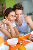 Couple using smartphone in morning Royalty Free Stock Photography
