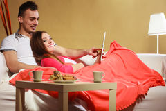 Couple using tablet browsing web internet. Royalty Free Stock Photos