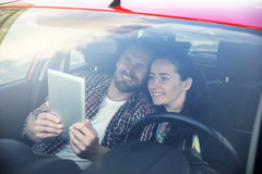 Couple using tablet in the car travel. Young beautiful couple using tablet pc in the car travel Stock Photos