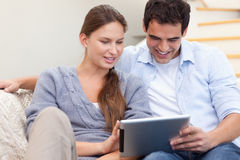 Couple using a tablet computer Stock Photos