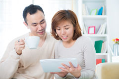 Couple using tablet computer Stock Photo