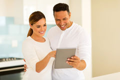 Couple using tablet computer Stock Photography