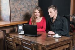 Couple using tablet computer in cafe Royalty Free Stock Images