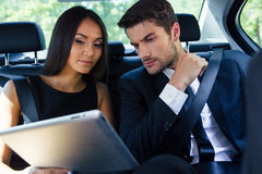 Couple using tablet computer in car Royalty Free Stock Image