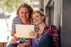 Couple using a tablet computer Stock Images