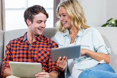 Couple using tablet computers Royalty Free Stock Photo