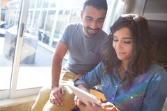 Couple using tablet Stock Photos