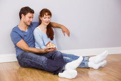 Couple using tablet at home Royalty Free Stock Images