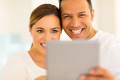 Couple using tablet pc Stock Photo