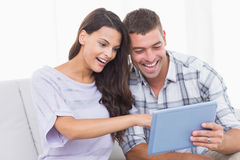 Couple using tablet PC together Stock Images