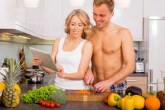 Couple using tablet for recipe Royalty Free Stock Image