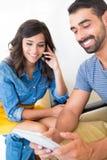 Couple using tech Stock Photo