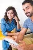 Couple using tech Stock Image