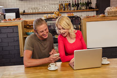 Couple using technology. In the cafe Royalty Free Stock Image