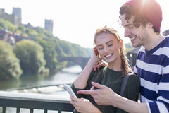 Couple using Technology Outdoors Royalty Free Stock Photos