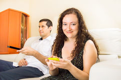 Couple using technology Stock Image
