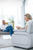 Couple using technology. While sitting at home Royalty Free Stock Photography