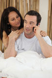 Couple using a telephone Royalty Free Stock Photography