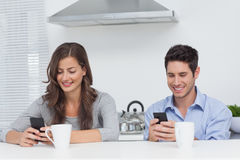Couple using their smartphones Stock Photography