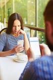 Couple using their smartphones Stock Photos