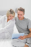 Couple using their tablet pc Stock Photo